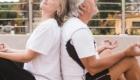 happy old couple doing yoga