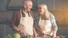 old couple having happy moment while preparing foods